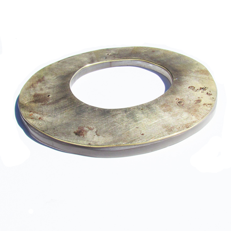 "Roxy Lentz -  ""I found it on the ground"" - Cuff/bangle of repurposed silver plate tray with fire patina. Riveted to found pexi-glass with frosted finish. About 5 inches across"