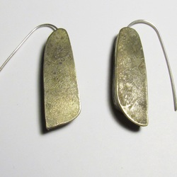 Half Hollow earrings by Roxy Lentz