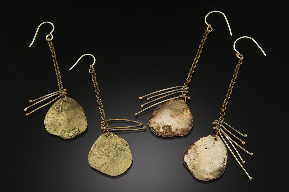 Roxy Lentz earrings of re purposed metal, fierce, wabi-sabi.